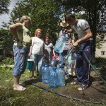 Residents collect water at a pumping station in Slaviansk