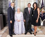 President Barack Obama and First Lady Michelle Obama greet His E
