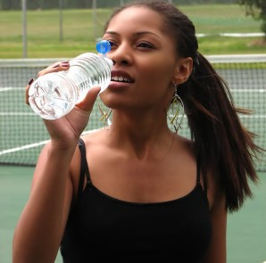 5176-a-beautiful-teen-african-american-girl-drinking-water-on-a-tennis-court-pv