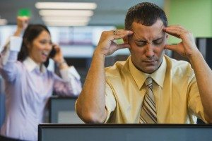 Businessman Irritated with Loud Coworker