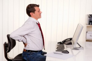 bigstock-young-man-in-office-with-compu-29935619