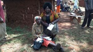 Grace Asio akiwa na mwandishi wa makala, Sidi Mgumia.