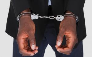 mans-hands-in-handcuffs